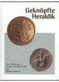 Guziki, historia i wpływy heraldyczne.